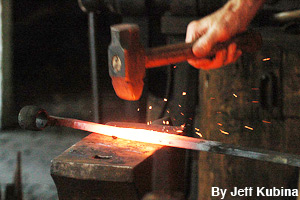 Pounding the red-hot metal