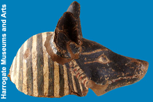 The mask of a jackal found in an ancient tomb