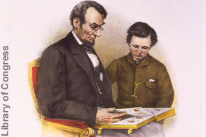Lincoln reading with his son, Tad