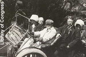 Roosevelt riding in a car