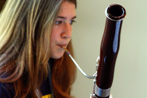 Blowing into a bassoon